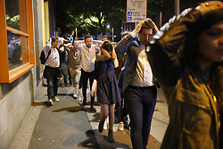© Licensed to London News Pictures. 03/06/2017. London, UK. People being evacuated near Borough Market after reports of an incident involving a vehicle and pedestrians in London Bridge.  Reports are saying a white transit van may have deliberately run down people crossing the bridge. Photo credit: Tolga Akmen/LNP