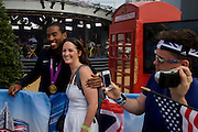Christian Taylor, the American world triple jump champion meets fans after his TV appearance on NBC's Today show broadcast live from the Olympic Park during the London 2012 Olympics. Taylor added Olympic gold to his tally, holding off his compatriot Will Claye in a contest whose earlier stages almost saw Taylor eliminated after two fouls.