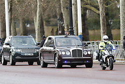 © Licensed to London News Pictures. 19/12/2019. London, UK. Queen Elizabeth II travels in a Bentley along The Mall for the State Opening of Parliament. The Brexit bill and NHS funding will be among legislation to be introduced in the Queen's speech. Photo credit: Peter Macdiarmid/LNP
