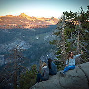 Visitors take selfies at Glacier Point inside Yosemite National Park on Sunday, September 22, 2019 in Yosemite, California. Glacier Point is a viewpoint above Yosemite Valley in the U.S. state of California. It is located on the south wall of Yosemite Valley at an elevation of 7,214 feet, 3,200 feet above Half Dome Village (Alex Menendez via AP)