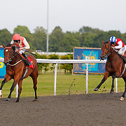Johara and Ted Durcan winning the 6.50 race
