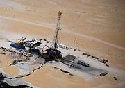 Oil industry in Ras Tanura area, Saudi Arabia,  drilling rig in desert 1979