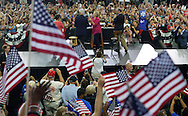 Democratic presidential nominee Hillary Clinton (C) claps with with her husband Bill (L,) and running mate Tim Kaine (R,) at a campaign kickoff rally after the Democratic National Convention in Philadelphia July 29, 2016. REUTERS/Rick Wilking