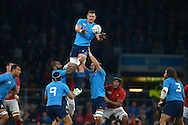 Josh Furno of Italy jumps to claim a line out ball against France. Rugby World Cup 2015 pool D match, France v Italy at Twickenham Stadium in London on Saturday 19th September 2015.<br /> pic by John Patrick Fletcher, Andrew Orchard sports photography.