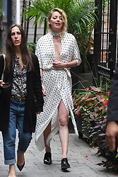 Amber Heard wears a loose flowing dress in Toronto, promoting her film with Cara Delevingne. Amber was spotted laughing with her cast mates as she promoted her film at the festival. 09 Sep 2018 Pictured: Amber Heard. Photo credit: MEGA TheMegaAgency.com +1 888 505 6342