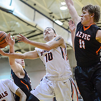 Gallup Bengal Nate John (10) is fouled by Aztec Tiger Chase Morrison (23) Tuesday at Gallup High School.