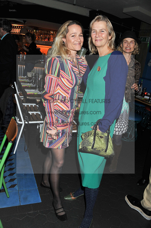 Left to right, TARA AGACE and PHILIPPA WALKER at a Mexican Feast cooked by Thomasina Miers in aid of the charity Too Many Women held at Wahaca Soho, 80 Wardour Street, London on 9th November 2011.