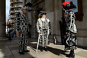 Pearly Kings and Queens at St Martin-in-the-Fields church for their annual Harvest Festival on 6th October 2019 in London, United Kingdom. The tradition of the Pearly Kings and Queens originated in the 19th century when London street sweeper Henry Croft decorated his uniform and began collecting money for charity. The annual harvest festival sees Pearly Kings and Queens gather to celebrate the autumn harvest with a church service.