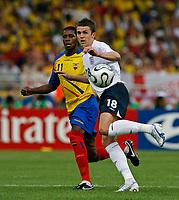 Photo: Glyn Thomas.<br />England v Ecuador. 2nd Round, FIFA World Cup 2006. 25/06/2006.<br /> England's Michael Carrick (R) and Ecuador's Agustin Delgado.