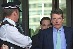 © London News Pictures. 04/07/2012. London, UK. BOB DIAMOND (right), former CEO of Barclays Bank leaving Portcullis House in London on July 4. 2012 after giving evidence to the Treasury Select Committee. BOB DIAMOND quit his role as Chief Executive of Barclays Bank following an interest rate-setting scandal that led to £290m in fines against the bank.  Photo credit: Ben Cawthra/LNP.