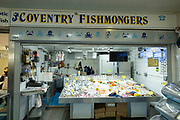 Interior of Coventry Market showing the fishmongers in the UK City of Culture 2021 on 23rd June 2021 in Coventry, United Kingdom. The market is an indoor market with vendors for fruit, vegetables, meat, fish, artisanal items & secondhand goods. There has een a market on this site since 1958. The UK City of Culture is a designation given to a city in the United Kingdom for a period of one year. The aim of the initiative, which is administered by the Department for Digital, Culture, Media and Sport. Coventry is a city which is under a large scale and current regeneration.