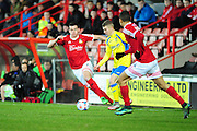 Harry White of Kidderminster Harriers (on loan from Barnsley) sprints away from Sean Newton of Wrexham during the Vanarama National League match between Wrexham AFC and Kidderminster Harriers at the Glyndŵr University Racecourse Stadium, Wrexham, United Kingdom on 23 February 2016. Photo by Mike Sheridan.