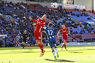Matthew Connolly of Cardiff City heads clear under pressure from Michael Jacobs of Wigan Athletic. EFL Skybet Championship match , Wigan Athletic v Cardiff city at the DW Stadium in Wigan, Lancs on Saturday 22nd April 2017.<br /> pic by Chris Stading, Andrew Orchard sports photography.