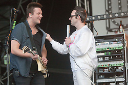 Rab Allan gets a kiss from James Allan, lead singer of Glasvegas on the main stage..Rockness, Sunday, 12th June 2011..RockNess 2011, the annual music festival which takes place in Scotland at Clune Farm, Dores, on the banks of Loch Ness near Inverness..Pic ©2011 Michael Schofield. All Rights Reserved..