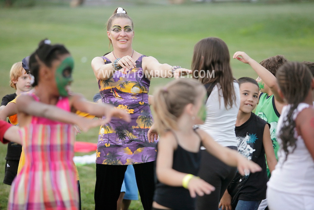 Middletown, New York - A female counselor and children from the Middletown YMCA summer camp perform during a talent show for parents and other campers on August 17, 2010.