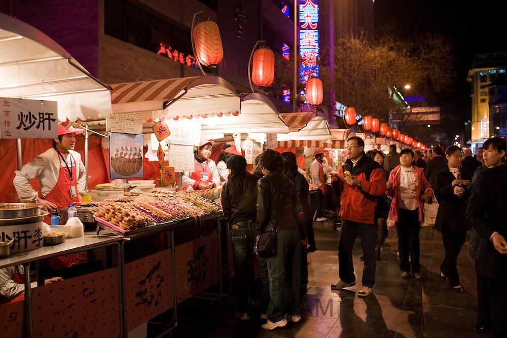 Stall selling meat kebabs in the Night Market, Wangfujing Street, Beijing, China