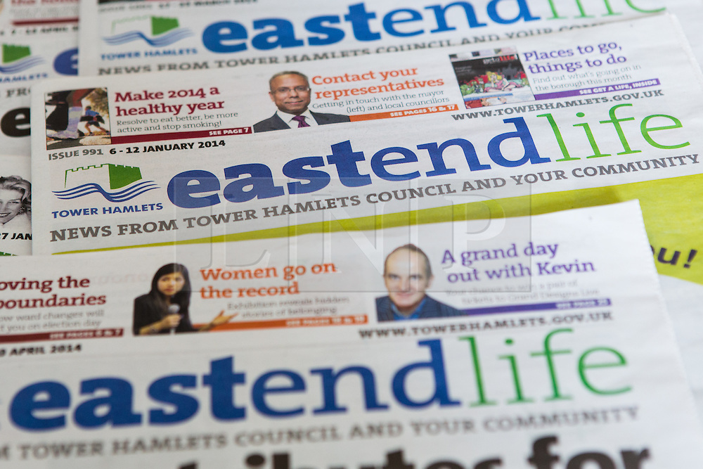 © Licensed to London News Pictures. 19/04/2014. London, UK. Copies of Tower Hamlets council newspaper, East End Life. Communities minister, Eric Pickles has demanded that five Labour-run London councils, including Tower Hamlets stop publishing free council funded newspapers and has given them a two-week ultimatum to explain why they should not face legal action for breaching publicity code. Photo credit : Vickie Flores/LNP.