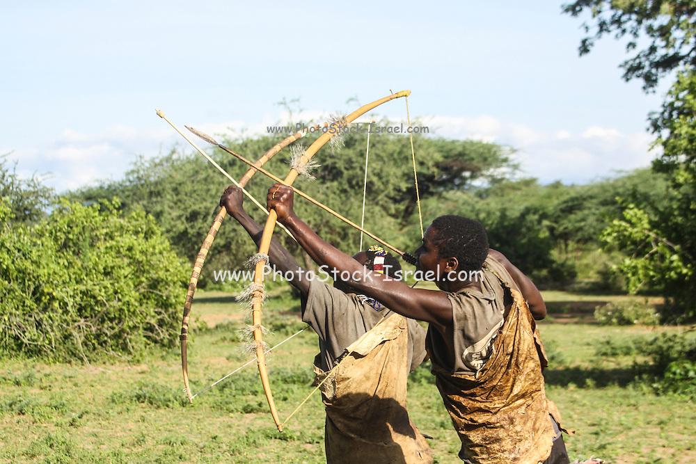 Africa, Tanzania, Lake Eyasi, Hadza hunters AKA Hadzabe Tribe practice with bow and arrows