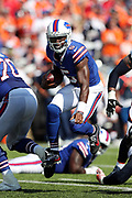 Buffalo Bills quarterback Tyrod Taylor (5) jumps over the outstretched arm of a defender as he runs for a second quarter gain of 5 yards to the Denver Broncos 27 yard line during the 2017 NFL week 3 regular season football game against the against the Denver Broncos, Sunday, Sept. 24, 2017 in Orchard Park, N.Y. The Bills won the game 26-16. (©Paul Anthony Spinelli)