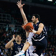 Anadolu Efes's Kerem Gonlum (L) and Dogus Balbay (R) during their Euroleague Top 16 basketball match Anadolu Efes between CSKA Moscow at the Abdi Ipekci Arena in Istanbul at Turkey on Thursday, March, 01, 2012. Photo by TURKPIX