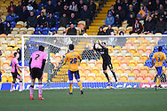 Mansfield Town Goalkeeper Scott Shearer saves the ball during the Sky Bet League 2 match between Mansfield Town and Northampton Town at the One Call Stadium, Mansfield, England on 28 March 2016. Photo by Jon Hobley.