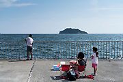 family recreational fishing at Umikaze park, Yokosuka with Tokyo Bay and Sarushima Island
