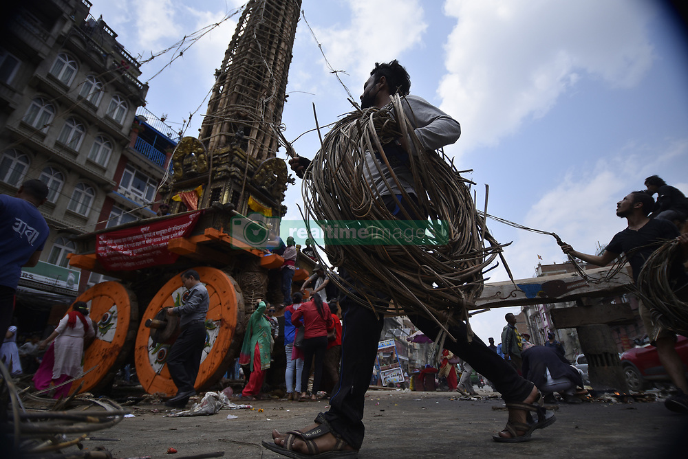 April 18, 2018 - Kathmandu, NP, Nepal - Nepalese people from Barahi community making the chariot of Idol Rato Machindranath 'Rain of God' at Pulchowk, Laltipur, Nepal on Wednesday, April 18, 2018. The longest festival of Nepal, Rato Machindranath Festival continues by pulling the chariot from Thursday, April 19, 2018 onwards from Pulchowk. Rato Machindranath is also said as the 'god of rain' and both Hindus and Buddhists worship the Machindranath in hope of good rain to prevent drought during the rice plantation season. (Credit Image: © Narayan Maharjan/NurPhoto via ZUMA Press)
