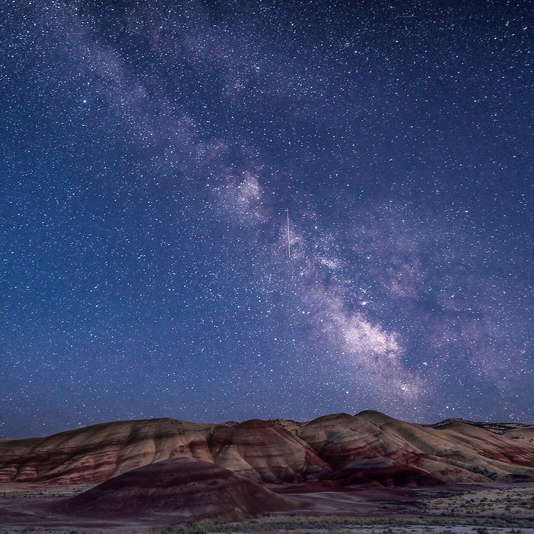 The galactic center of the Milky Way descends over the Painted Hills Unit of John Day Fossil Beds National Monument, in Oregon.