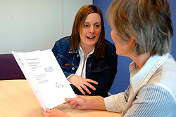 Housing Officer discussing rental agreement with a tenant; Housing Association office; York UK