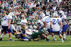 17 September 2011: Cameron Blossom braces to hit the turf while being tackled during an NCAA Division 3 football game between the Aurora Spartans and the Illinois Wesleyan Titans on Wilder Field inside Tucci Stadium in.Bloomington Illinois.