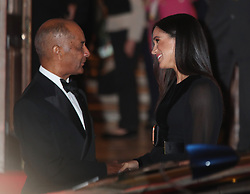 The Duchess of Sussex, with the Lord-Lieutenant of Greater London Sir Kenneth Olisa, leaves after attending the opening of Oceania at the Royal Academy of Arts in London.