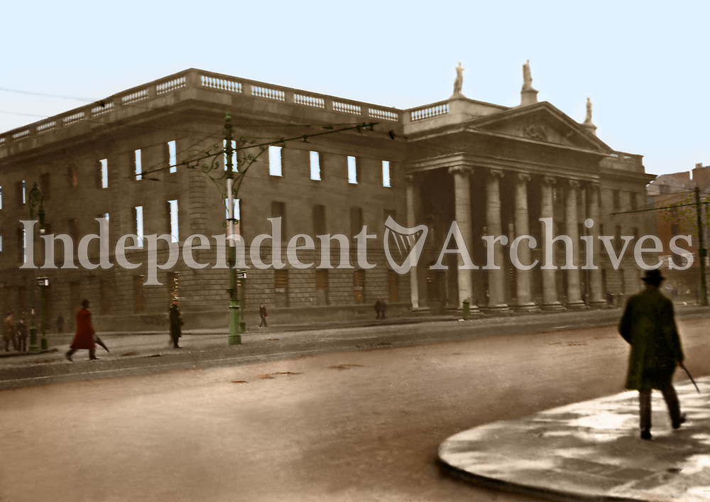 The ruins of the General Post Office (GPO) on Sackville (O'Connell) St. Having been reopened after extensive renovations some weeks prior to the Easter Rising, it was used as the headquarters garrison and was destroyed by fires. The outer walls remained intact and the GPO repoened in 1929. (Part of the Independent Newspapers Ireland/NLI Collection) Colourised by Tom Marshall (PhotograFix).