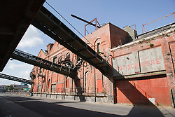 Grimsby Ice House, built 1900, now derelict, showing conveynors which took ice directly to trawlers for packing fish in. Also shows French writing from when it was used as a set for the film Atonement.