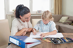 Woman helping her son with his homework, Bavaria, Germany