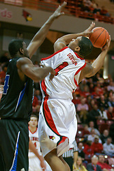 15 January 2005<br /> <br /> Lorenzo Gordon steps in front dodges Pete Eggers to make room for a spinning fade away jumper over Aliou Keita as the<br /> Illinois State University Redbirds keep the Drake Bulldogs on a leash as they pull ahead in the 2nd half for a74 - 61 Victory.  Redbird Arena, Illinois State University, Normal IL