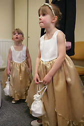 Two bridesmaids at a registry office wedding,
