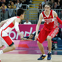 31 July 2012: Russia Alexey Shved brings the ball upcourt against China Ailun Guo during the 73-54 Russia victory over China, during the men's basketball preliminary, at the Basketball Arena, in London, Great Britain.
