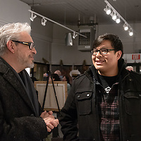 Braidon Titla, 18, right, and art enthusiast Ken Nunez, 53, left, converse during the 15 in 30 challenge art show at the art123 Gallery in Gallup on Saturday.