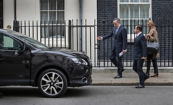 © Licensed to London News Pictures. 14/10/2016. London, UK. Nissan Chairman and CEO Carlos Ghosn walks towards his Nissan Qashqai car as he leaves Number 10 Downing Street after holding talks with Prime Minister Theresa May. Mr Ghosn has stated that he would like a government pledge to  compensate Nissan for any tariffs that may be imposed after the UK leaves the EU. Photo credit: Peter Macdiarmid/LNP