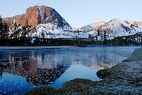 The first rays of the sun hit Mt. Haynes near the Madison River on a frost Saturday morning in Yellowstone National Park. The park opened its west entrance and a limited number of roads for the season Friday..