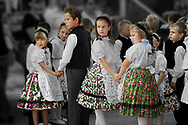 traditional children dancers in local german Svab traditional  dress - Annual wine harvest festival ( szuret fesztival ) . Hajos ( Hajós); Hungary .<br /> <br /> Visit our REPORTAGE & STREET PEOPLE PHOTO ART PRINT COLLECTIONS for more wall art photos to browse https://funkystock.photoshelter.com/gallery-collection/People-Photo-art-Prints-by-Photographer-Paul-Williams/C0000g1LA1LacMD8