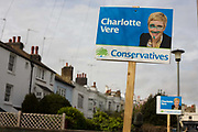 The face of the Conservative candidate in Britain's general election Charlotte Vere has been defaced by the childish scrawls over her eyes and mouth. In this residential street of the Brighton Pavillion constituency, we see the one sign that urges voters to support the Tories, spoiled and another in the background untouched by the political jokers. Vere is a Tory business woman fighting this parliamentary seat in East Sussex under the leadership of party leader David Cameron.