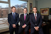 Portrait of three men in the banking and finance industry in Boulder, Colorado with a view of the Flatirons behind them.
