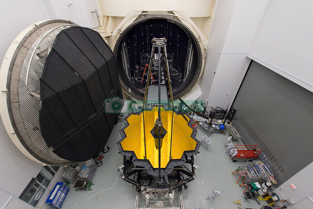 Jun 19, 2017 - Houston, Texas, U.S. - NASA's James Webb Space Telescope sits in front of the door to Chamber A, a giant thermal vacuum chamber located at NASA's Johnson Space Center.  The telescope will soon be moved into the chamber, where it will spend a hot Houston summer undergoing tests at sub-freezing cryogenic temperatures.  The telescope will operate below an extremely cold 50 K (-223? C or -370? F) in space, so NASA is simulating those conditions on the ground, ensuring the optics and instruments will perform perfectly after launch. The James Webb Space Telescope is the scientific successor to NASA's Hubble Space Telescope. It will be the most powerful space telescope ever built.  (Credit Image: ? Desiree Stover/NASA via ZUMA Wire/ZUMAPRESS.com)