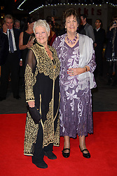 JUDI DENCH and PHILOMENA LEE  arrives for the West End hit production of The Bodyguard, which stars, Beverley Knight, and Tristan Gemmill at the Adelphi Theatre, London, UK,  Wednesday, 16th October 2013. Picture by i-Images