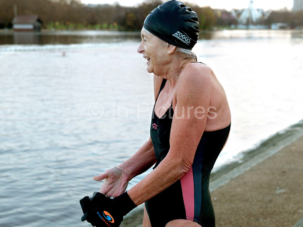 Mary Olivari, a member of the Serpentine Swimming Club, Hyde Park, London, UK. The Serpentine Lake is situated in Hyde Park, London's largest central open space. The Serpentine Swimming Club was formed in 1864 'to promote the healthful habit of bathing in open water throughout the year'.  Its headquarters were beneath an old elm tree on the south side of the lake, a wooden bench for clothing being the only facility.  At this time London was undergoing rapid expansion and Hyde Park was now in the centre of a densely populated built up area and provided a place of relaxation to its urbanised masses. Now, the club has its own (somewhat spartan) changing facilities and members are  permitted by the Royal Parks to swim in the lake any morning before 09:30.  They race every Saturday morning throughout the year, regardless of the weather.