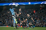 Bacary Sagna (Manchester City) wins the header beating Mikael Lustig (Celtic) during the Champions League match between Manchester City and Celtic at the Etihad Stadium, Manchester, England on 6 December 2016. Photo by Mark P Doherty.