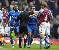 Fotball<br /> Premier League 2004/05<br /> Aston Villa v Birmingham<br /> Villa Park<br /> 12. desember 2004<br /> Foto: Digitalsport<br /> NORWAY ONLY<br /> Aston Villa's Olof Mellberg (far right) argues with Birmingham City's Clinton Morrison (far left) as they are parted by the assistant linesman and Birmingham City's David Dunn during a firey derby match