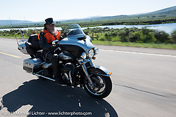 79-year old Bob Dobbs, who lives half the year in Edinburg, TX and the other half in Newcastle, CO, on his 2015 Ultra Limited riding from Steamboat Springs to Doc Holliday's Harley-Davidson in Glenwood Springs during the Rocky Mountain Regional HOG Rally, Colorado, USA. Thursday June 8, 2017. Photography ©2017 Michael Lichter.