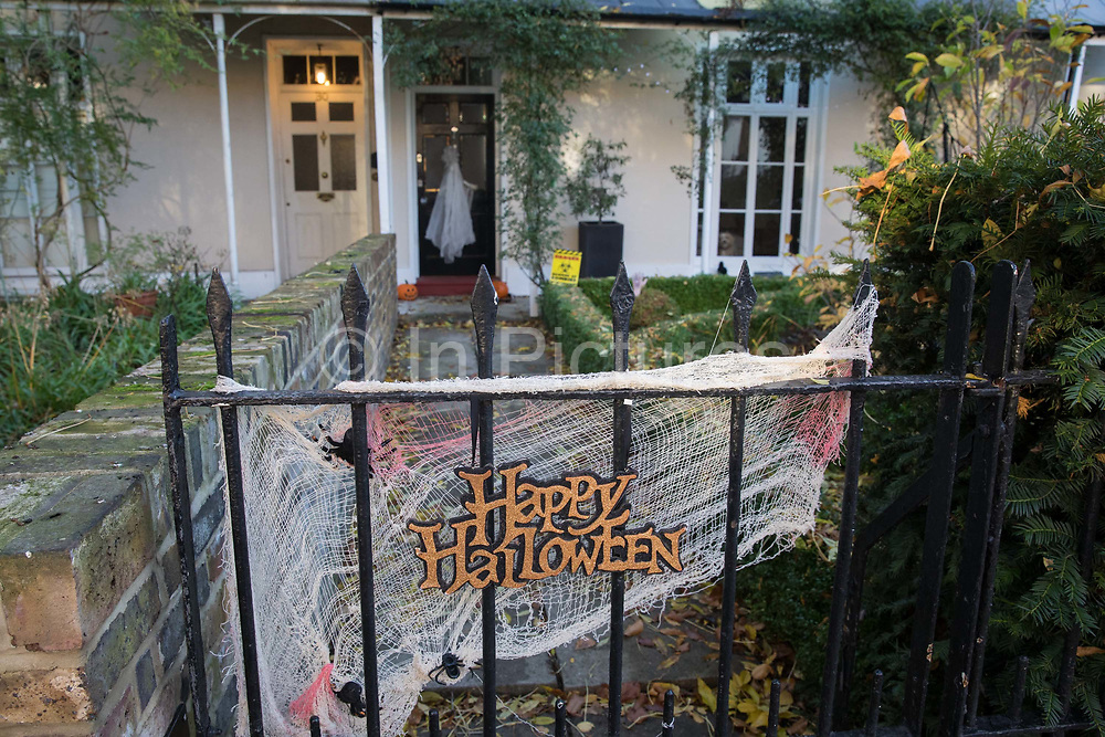 Halloween decorations are pictured outside a house on 31 October 2020 in Windsor, United Kingdom. Halloween celebrations, and in particular the custom of trick-or-treating, will vary across the UK this year due to coronavirus restrictions which differ by Tier alert levels and the Prime Minister's official spokesman has urged people to apply common sense.